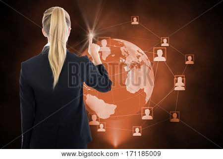 Business woman pointing somewhere against futuristic technology interface