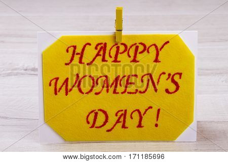 Women's Day card with clothespin. Fabric greeting card on paper. Congratulation to lovely women. How to make simple present.