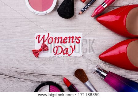 Women's Day card and cosmetics. Greeting card and make-up kit. Emphasize your beauty. Present cosmetics on holiday.