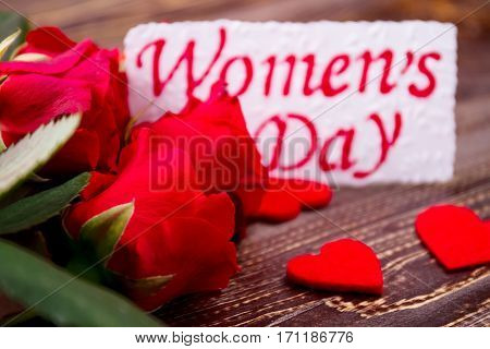 Roses and Women's Day greeting. Flowers and fabric hearts. Share small pleasures. Traditional spring gift.