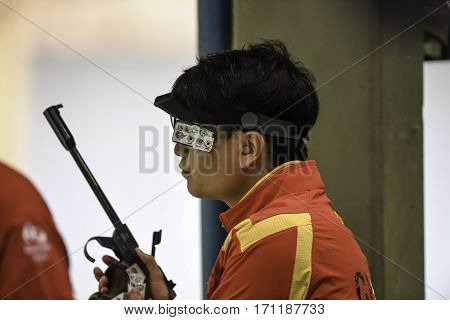 Rio Brazil - august 10 2016: WANG Zhiwei (CHN) during shooting 50m Pistol Men Shooting at Olympic Games 2016 in Olympic Shooting Centre Deodoro