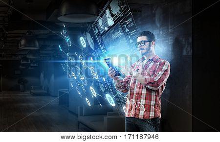 Guy using tablet pc . Mixed media