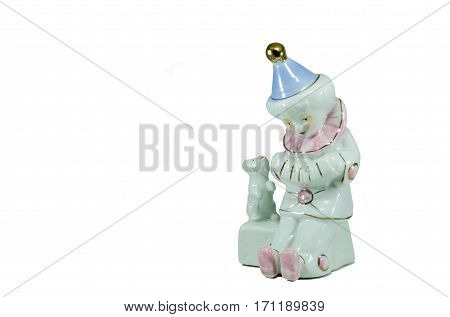 Isolated Porcelain Figurine Sad Clown.