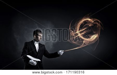 Businessman demonstrating magic . Mixed media