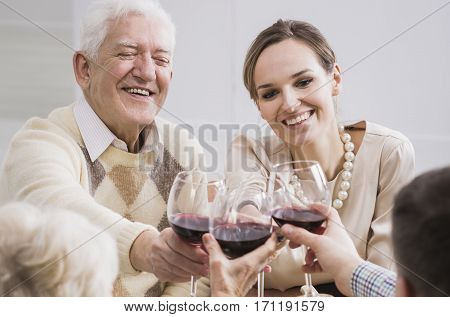 Cheerful Father And Daughter Making A Toast