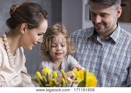 Young Parents With Child Eating Dinner
