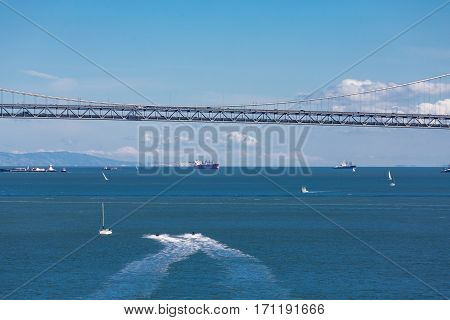 Boats and Jet Skis Under Bay Bridge in San Francisco