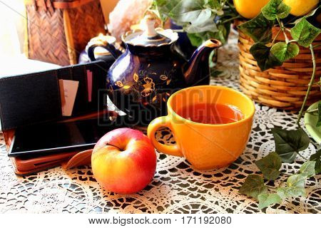 Tea and an Apple. Delicious, fragrant and hot tea. Herbal tea and an Apple,red,juicy,sweet. Nice to enjoy this tea.
