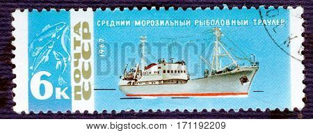 USSR - CIRCA 1967: Postage stamp printed in USSR with a picture of middle freezer fishing trawler, from the series