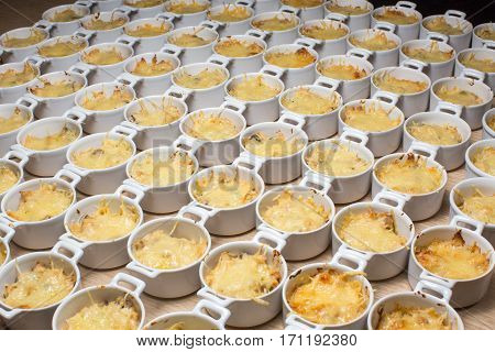 Buffet julienne fondue melted cheese in portions in bowls