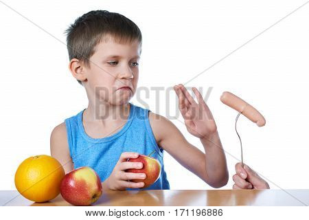 Boy With Apples And Orange Against Harmful Sausage