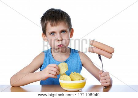 Little Boy With Fat Cheeks Eating Sausages And Potato Chips Isolated