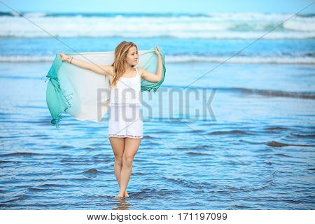 Woman On The Shore With Wrap