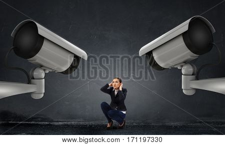 Camera keep an eye on woman . Mixed media