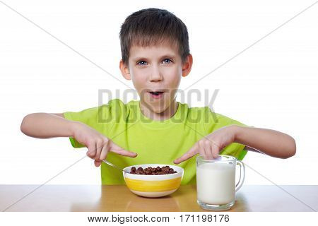 The little boy eating breakfast isolated white