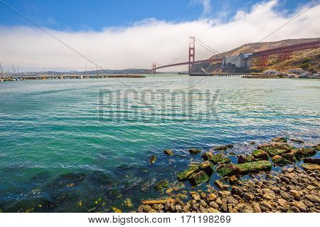 Landscape of Golden Gate Bridge from Presidio Yacht Club, north shore, Horseshoe Bay, Sausalito, California, United States. Symbol, icon and landmark of San Francisco. Travel and holidays concept.
