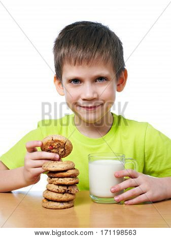 Little Boy Has Breakfast Cookies And Milk Isolated
