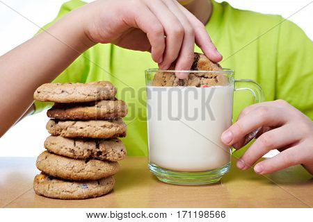 The child has breakfast cookies and milk