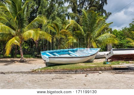 Fishing boats on the beach of Tamarin Bay in Mauritius