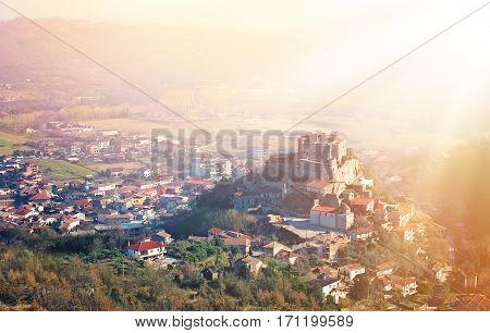 Panoramic viev on an ancient castle in Italy at sunrice time.