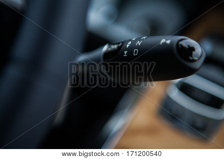 Close up shot of a car's gear shifter.