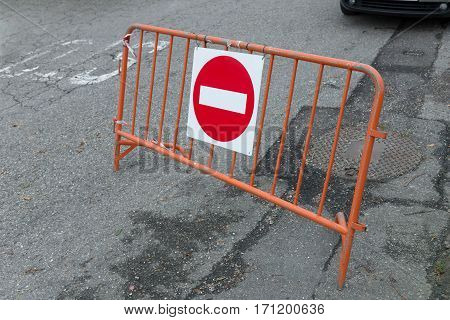 traffic sign no entry on metallic barrier