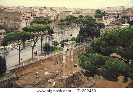 Aerial cityscape of Rome with Forums and Colosseum, Rome, Italy