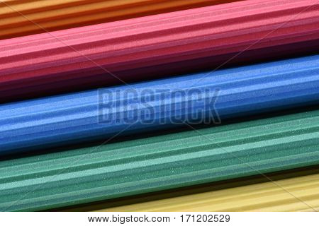 Corrugated colorful paper roll as abstract background