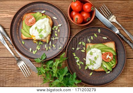Sandwich with avocado and poached egg. Breakfast.