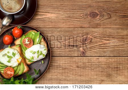 Sandwich with avocado and poached egg. Breakfast .