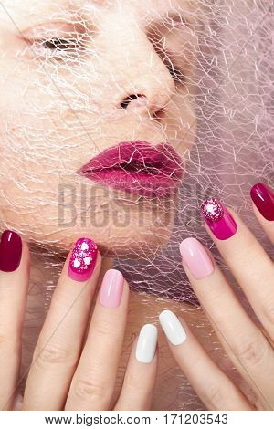 Pink cherry nail design for nail glitter different shapes on the girl with the Burgundy lips.