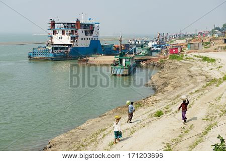 CHHOTA DHULANDI, BANGLADESH - FEBRUARY 19, 2014: View to the ferry pier and river bank in Chhota Dhulandi, Bangladesh. Ferry is a very important way of transportation in Bangladesh.