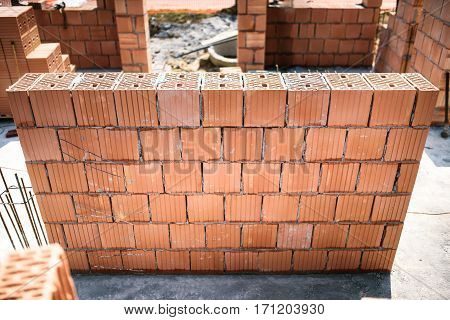Building Construction Site With Brickwork And Bricklaying. Industrial Details