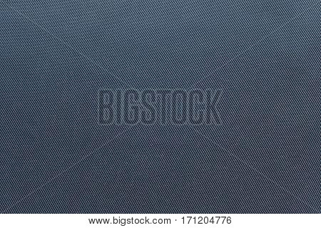the textured background of fabric or textile material of blue color