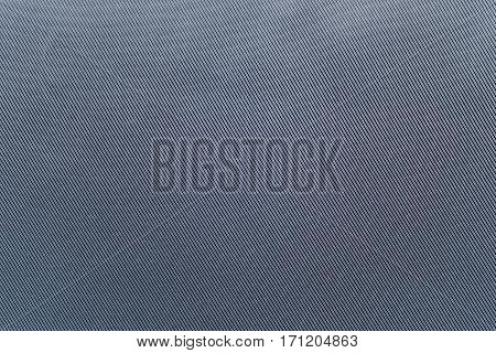 the textured background of fabric or textile material of faded blue color