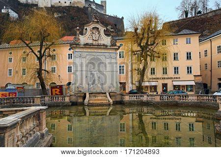 SALZBURG/ AUSTRIA - FEBRUARY 24, 2016: Horse well at the Kapitelplatz Square. Salzburg Austria