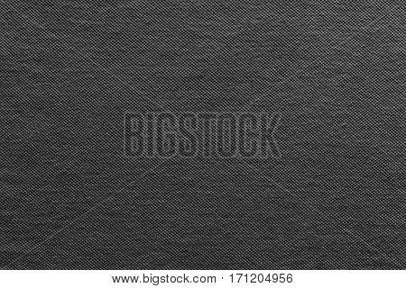 the textured background of cotton fabric or textile material of black color