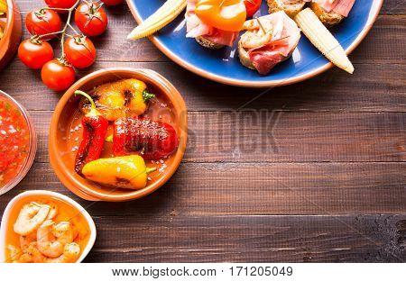 Mediterranean Snacks - Tapas On Wooden Table