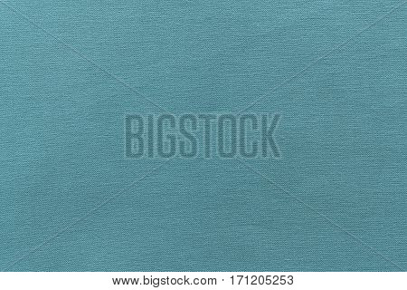 texture and background of rough fabric or cotton material of turquoise color