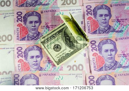 One Hundred Dollars Banknotes On The Background Of Ukrainian Hryvnas