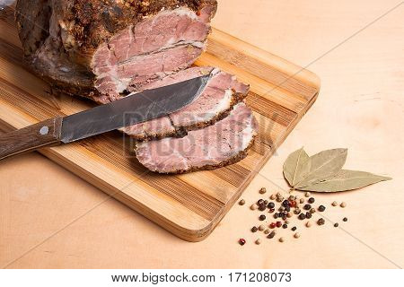 Sliced Baked Pork With Herbs And Spice On Wooden Board.