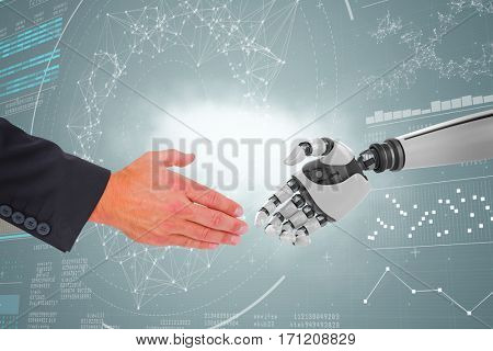 Businessman holding his hand out against genes diagram on black background