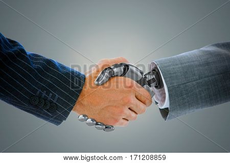 Cropped image of businessman shaking hand of robot against blue vignette background