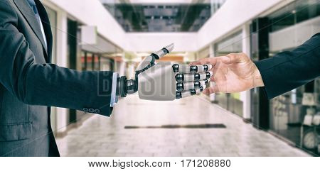 Hand presenting against interior of modern shopping mall