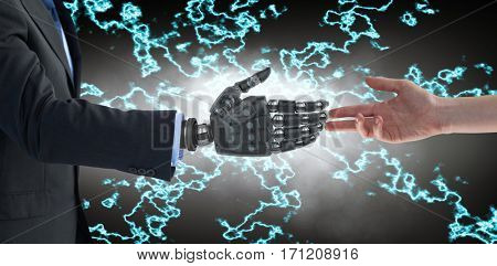Cropped hand of woman against cropped image of businessman with robotic hand
