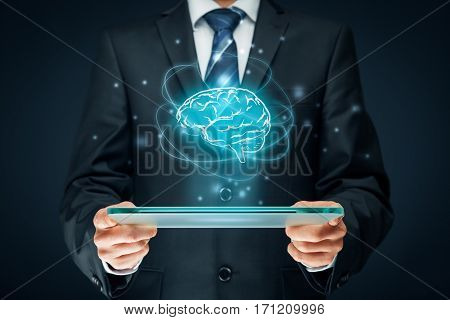 Artificial intelligence (AI) machine deep learning data mining expert system software and another modern computer technologies concepts. Brain representing artificial intelligence and businessman holding futuristic tablet.
