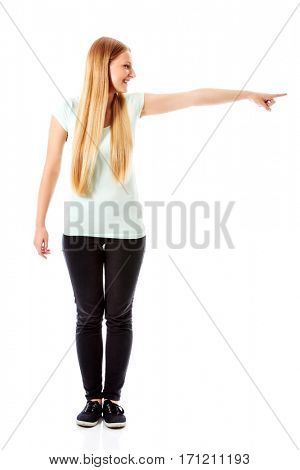 Attractive woman looking and pointing sideways.