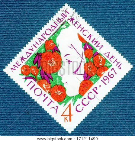 USSR - CIRCA 1967: Postage stamp printed in USSR with a picture of profile of the girl on a background of flowers - a symbol of International Women's Day March 8. circa 1967
