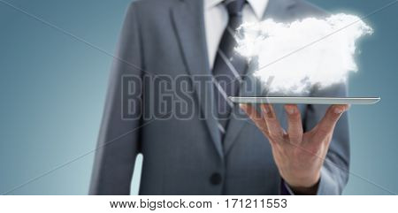 Midsection of businessman with digital tablet against grey vignette 3d