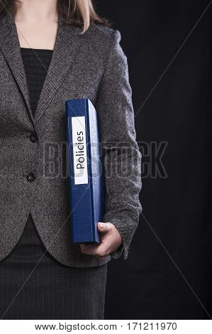 Office worker holding folder with insurance policies